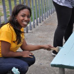 Oglethorpe volunteers painting primer on picnic tables